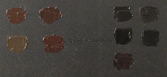 De gauche à droite : Ombre brûlée, Brun oxyde, Noir de Mars, Noir de Vigne, Terre d'ombre naturelle, Brun Still de grain, Terre de Cassel, Noir d'ivoire, Noir de Pérylène